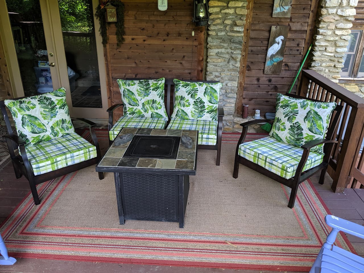 Gas fire pit and comfy patio chairs for relaxing outside and out of the weather