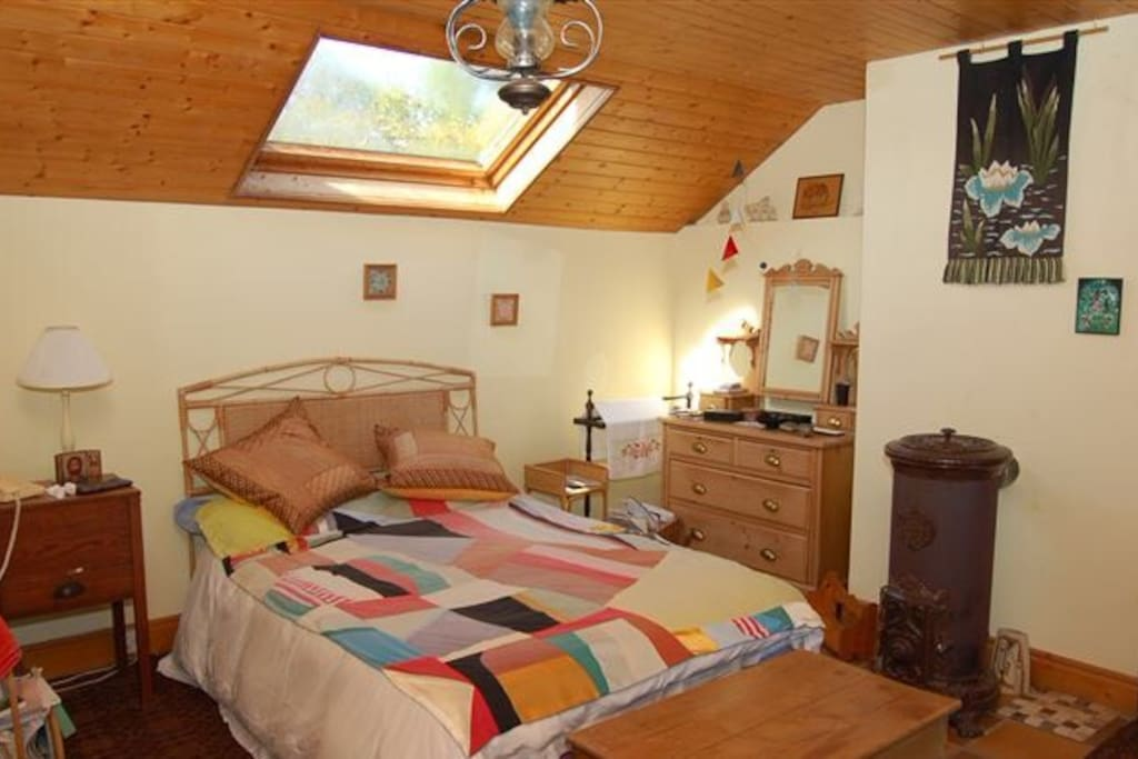 The bedroom with wood burning stove