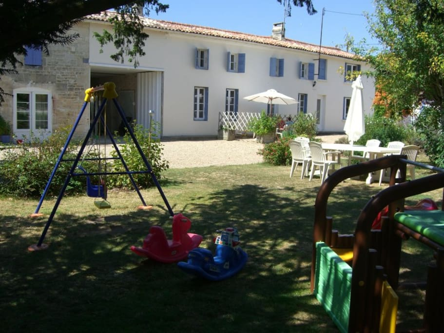 Farmhouse and Well Cottage from gardens and toddler play area
