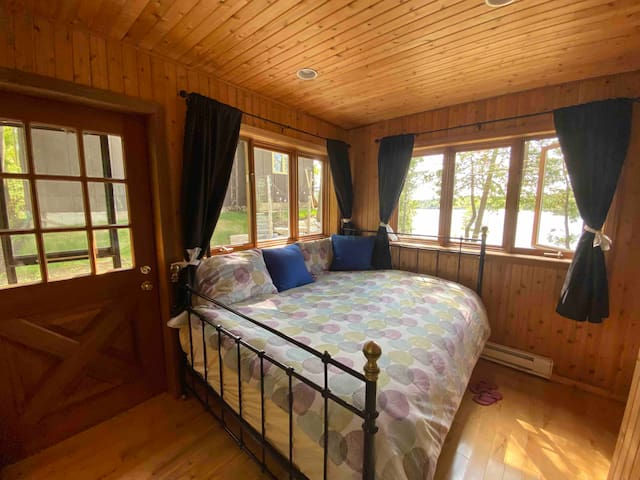 3rd bedroom has a lake view. It is equipped with queen size bed and the additional side room, with  fold away bed, just in case. It is housed in a winterized, heated bunkie full of windows.