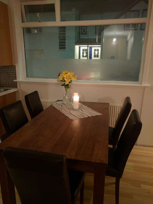 Dining table, there are 6 matching chairs. Wooden curtains missing here