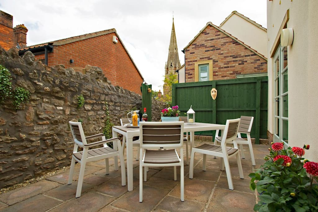 Spacious private patio, perfect for al fresco drinks, sunny breakfasts, BBQs (large BBQ provided), gate to garage area.