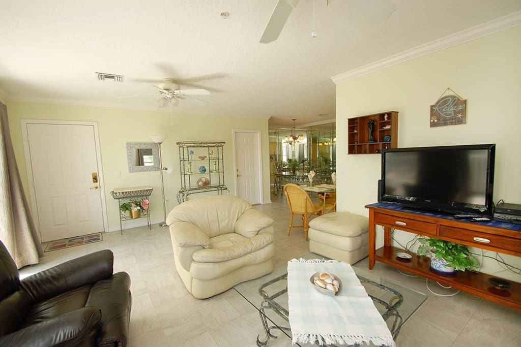 Living room, flat screen television and HD television with over 200 channls