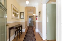 View at entry to shared lobby, studio door to right, other guest's door at end of hall.