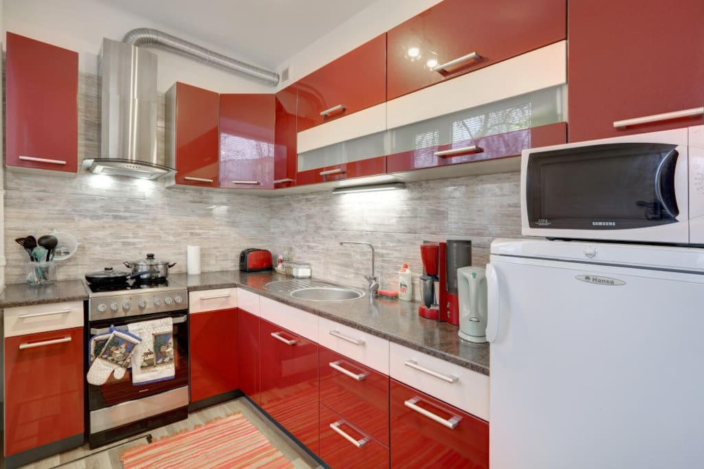Kitchen with necessary appliances.
