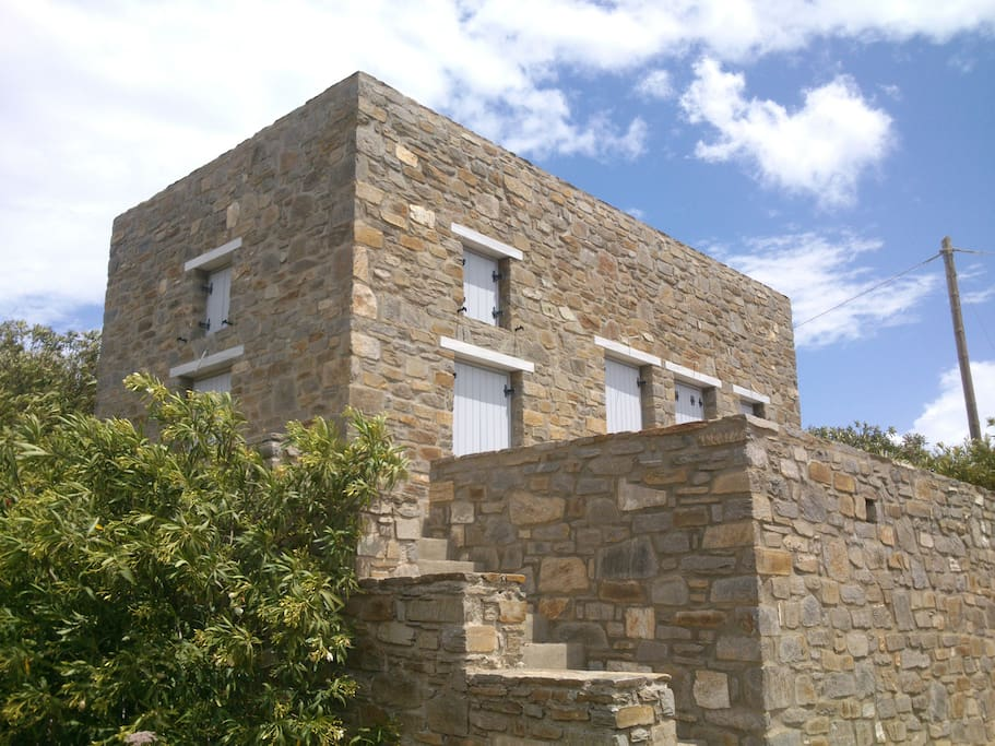 Detailed view of the stone house.