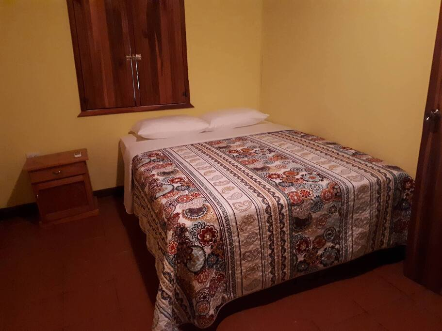Queen size bed in our one bedroom Costa Rican style casita