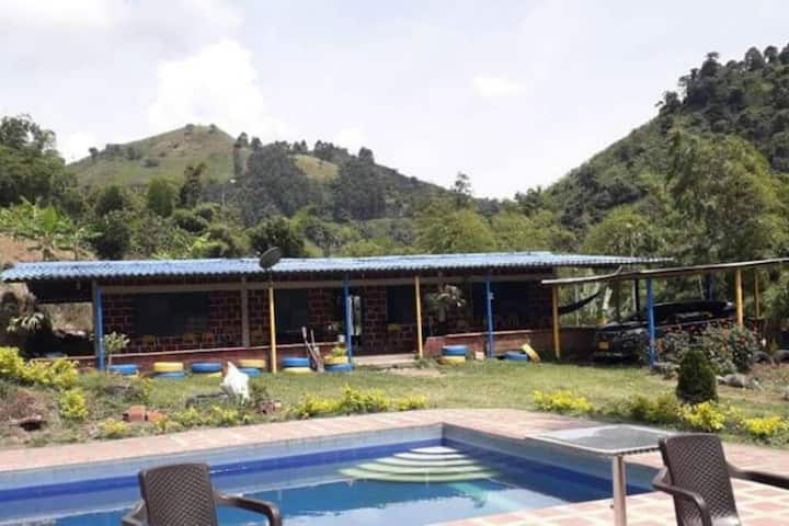 Typical farm with a big pool, fruit trees and surrounded by mountains!
