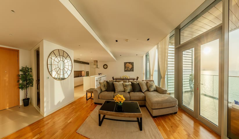 The bright sun filled living area will full sea views