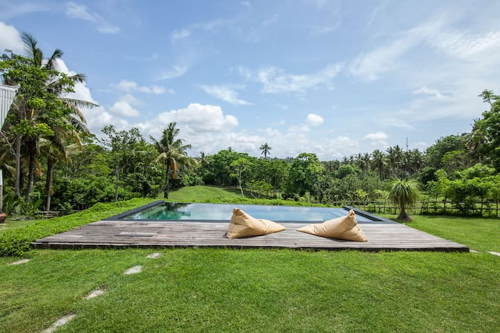 Spoil yourself! Share a bottle of wine or a few Bintangs by the infinity pool
