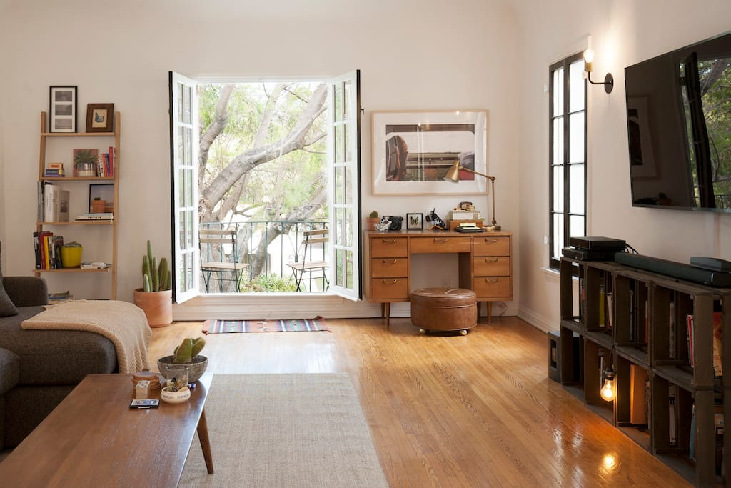 Open the doors to a beautiful breeze and outdoor balcony overlooking the street