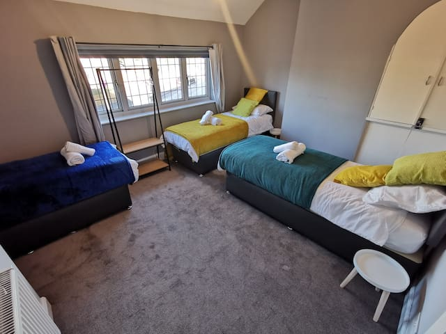 Third bedroom features three comfortable single beds.