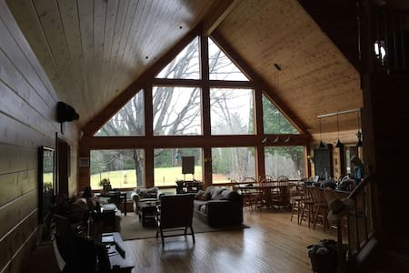 Beautiful home in the woods for weddings & groups.