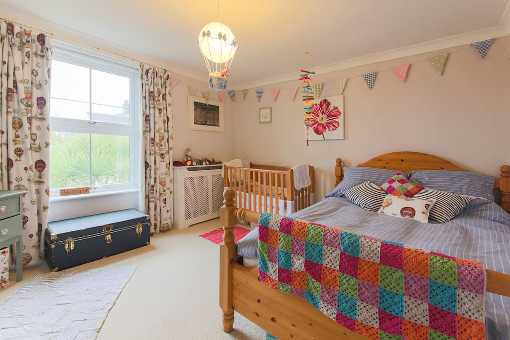 Large, light family room. King bed, cot and single bed.