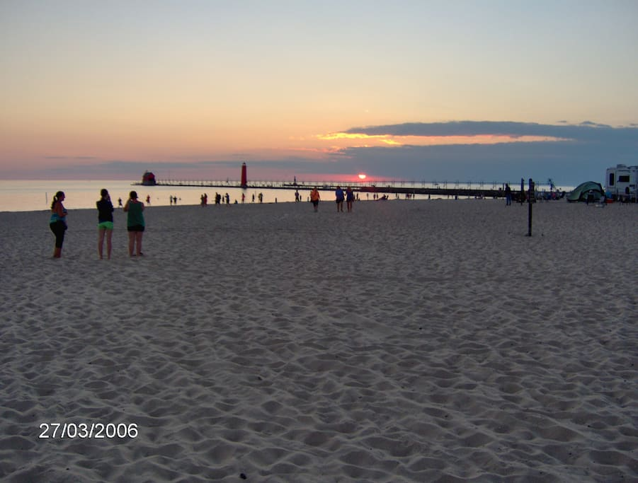 Sunset over Grand Haven state park and pier