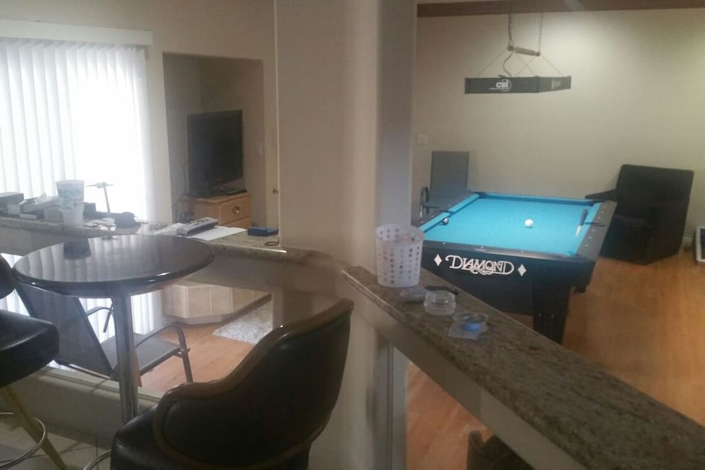 My other pool table is a 7-foot Diamond table. Plenty of room to watch matches on two different tables elevated viewing areas. It has the feel of a pool hall or Sports Bar with the luxury of a large kitchen and Patio close by.