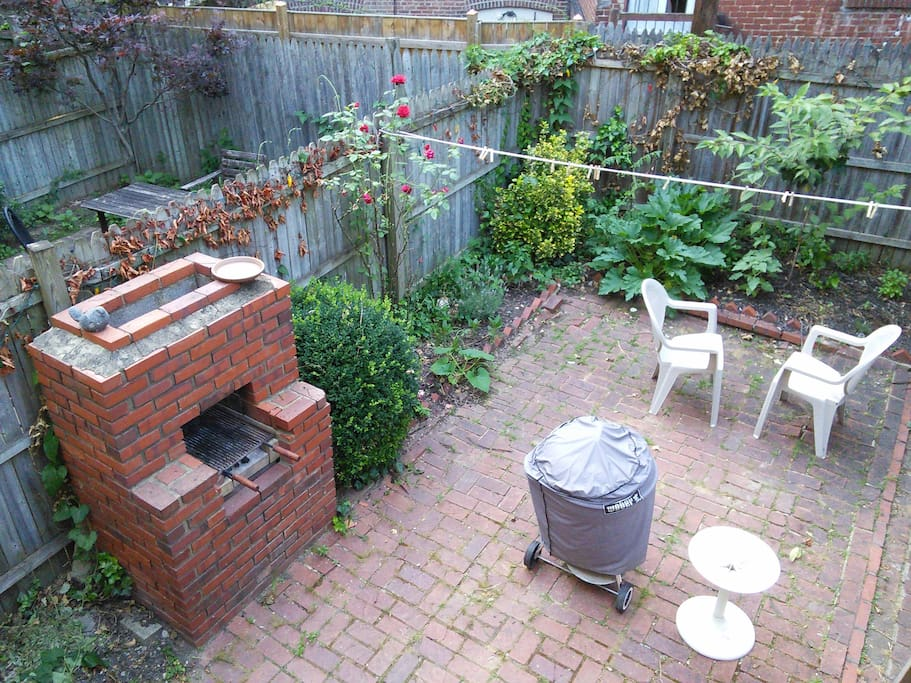 Back yard both brick and coal fire grills and seating area