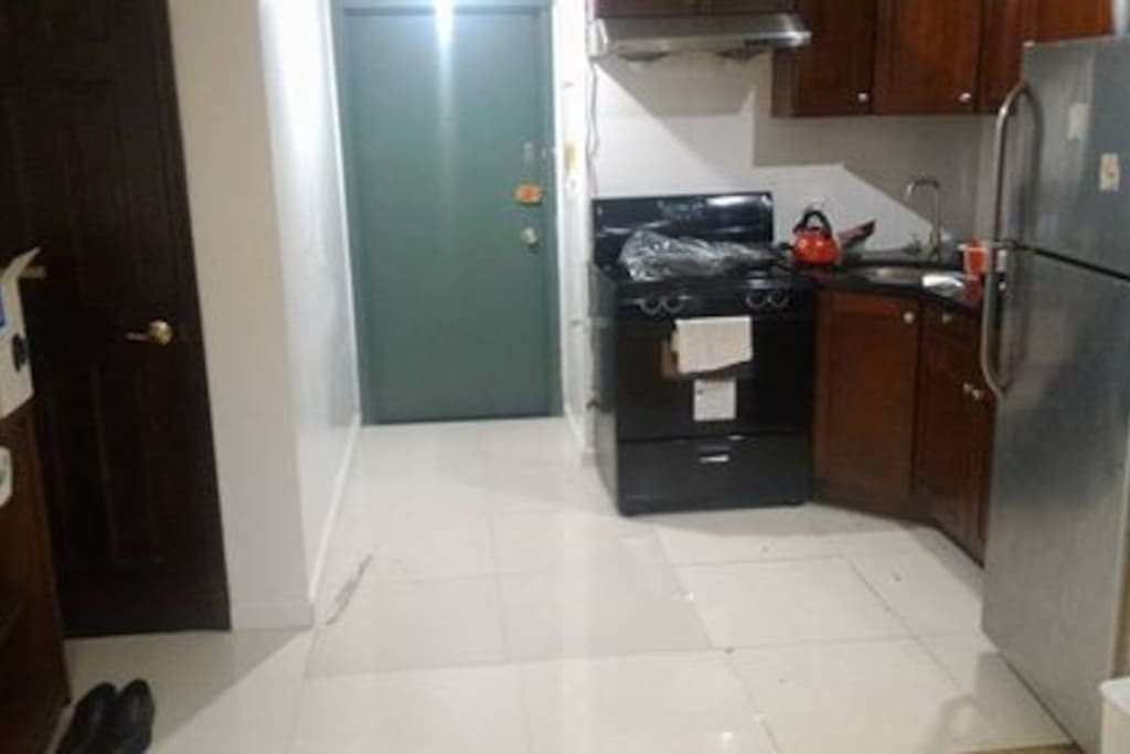 Entrance next to kitchen, only fridge and microwave is available for use