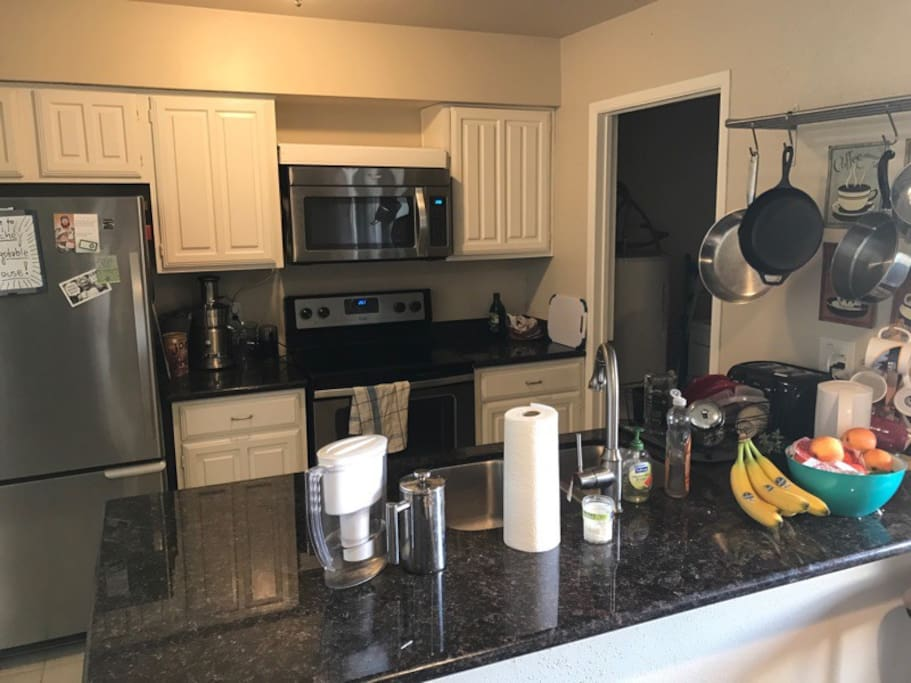 Kitchen amenities include a dishwasher and free laundry