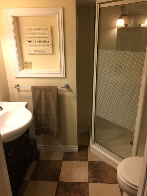 Private bathroom with toilet, vanity and shower
