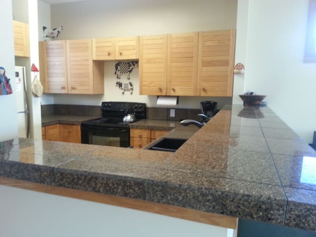 New granite, new tile in the fully equipped kitchen, plus lots of light!