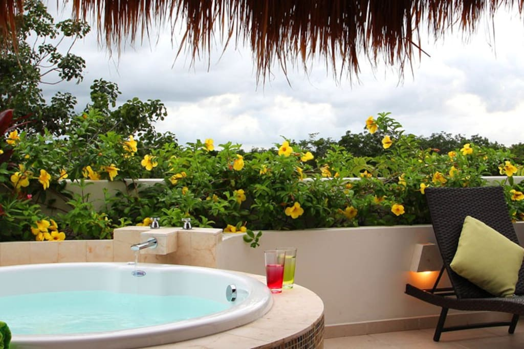 Kick Back and Soak Up the Sun on the Private Roof Top Patio