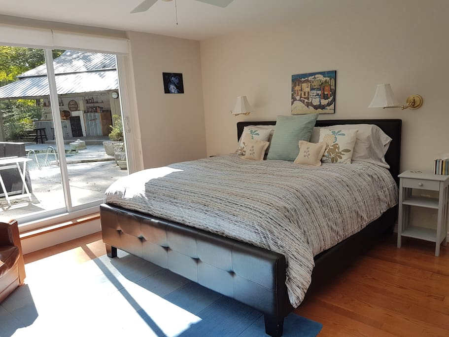 Master bedroom:  king bed, ensuite bathroom, beautiful view of pool deck / gardens / forest