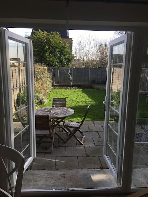 Double doors open to giant garden