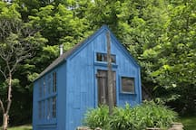 This is the Blue House that gives our Farm its name. Built on the same measurements as Thoreau's cabin. Available to paint, write, or dream in.