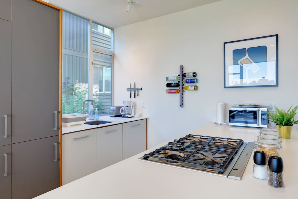 The open kitchen has large counter tops and all the essentials to cook at home.