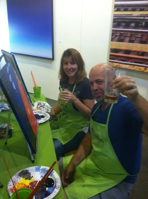 Your hosts, enjoying paintnite at First Magnitude Brewery in Gainesville.