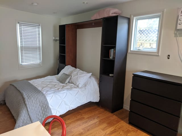 Full double Murphy bed , nicely tucked in the corner
