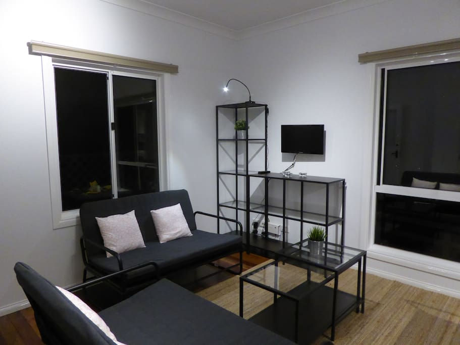 Lounge - three sofa beds and TV with built in DVD player