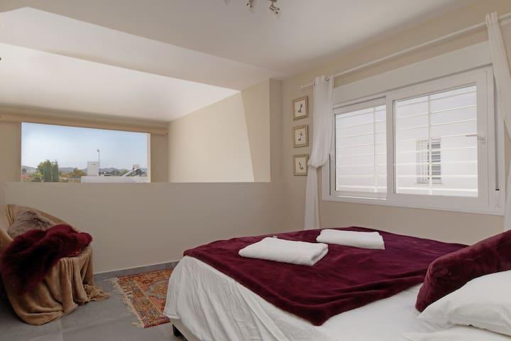 Master super king size bedroom . First floor - mezzanine style overlooking lounge . Ensuite with walk in wardrobe
