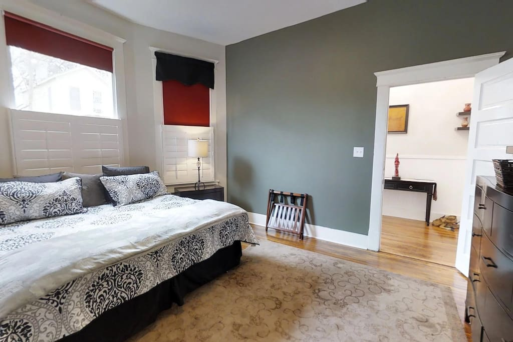 Master Bedroom with King Bed, private bath and 65 inch TV.