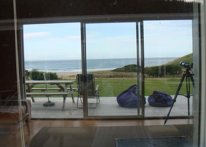 View from inside house to beach