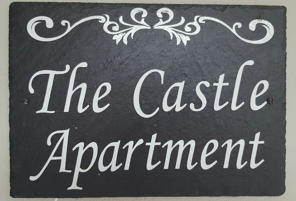 Welcome to the Castle Apartment! (sign outside)