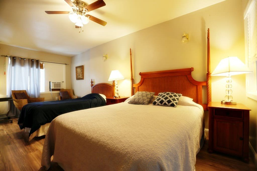 One Queen bed and Single bed in the bedroom.