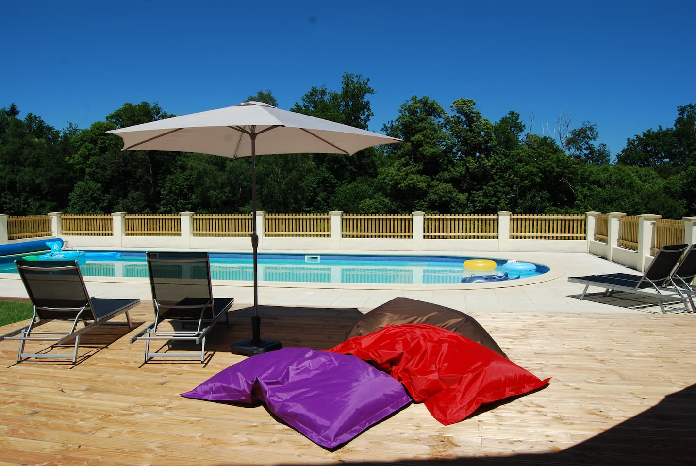 Large communal outdoor heated swimming pool.