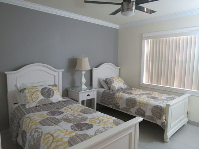 Guest bedroom with two twin size beds.