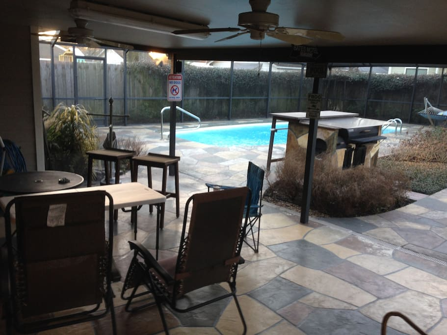Outdoor covered patio with smoker/BBQ and full screen enclosure