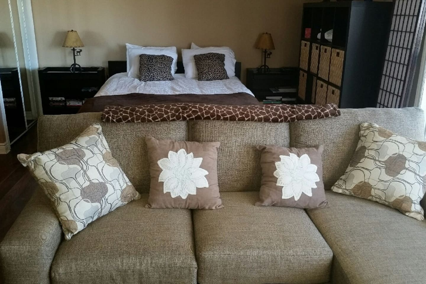 Living room / bedroom combination. Living room has new queen size sofabed with chaise lounge.