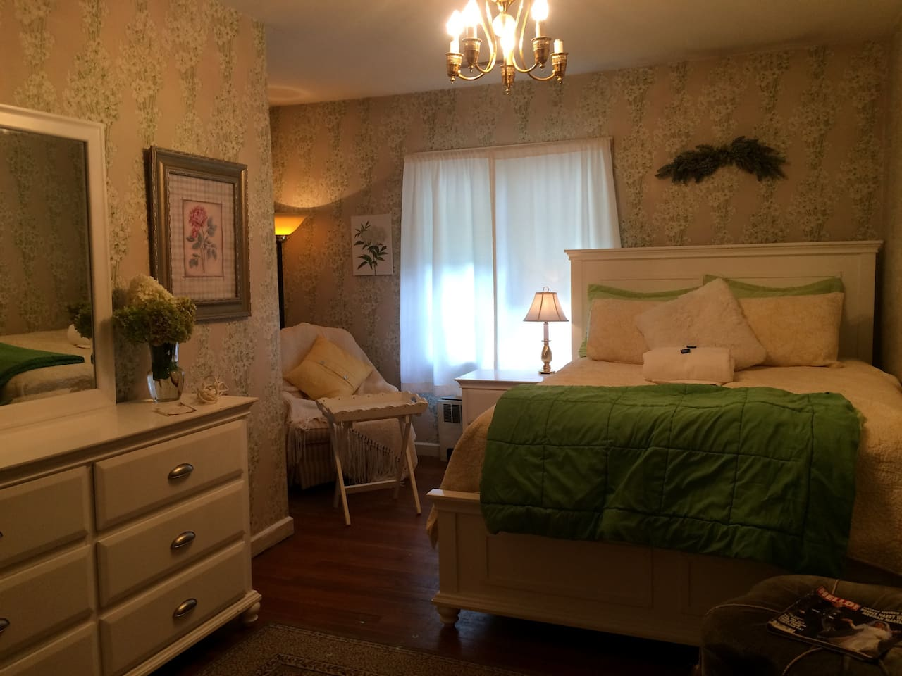 Comfortable queen bed with deluxe mattress.chair with breakfast tray.