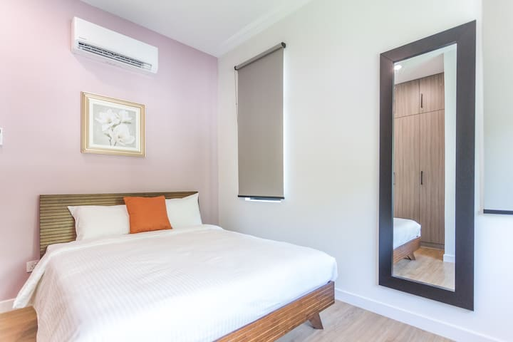 2nd Floor Bedroom 4 with 1 Queen Bed, table lamp and air-conditioner
