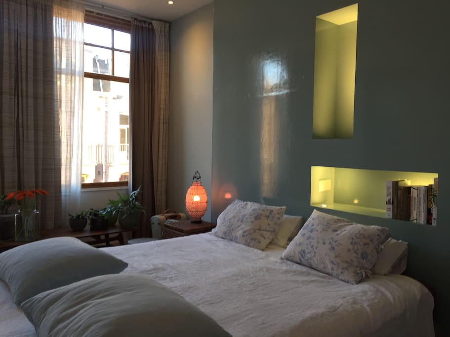 Light bedroom with curtains.