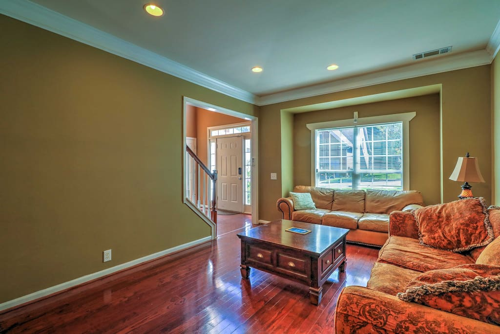 The formal living room opens up to the dining room and is the perfect spot to relax and read a book.