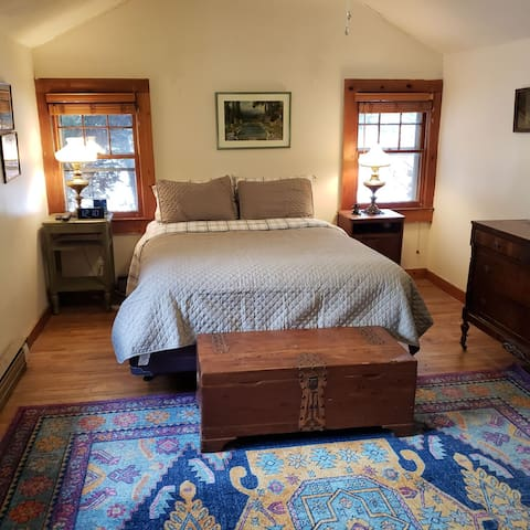 Romantic master bedroom has its own full bathroom.