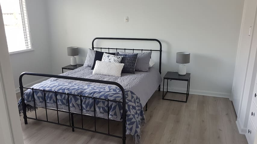 Large master bedroom with queen bed