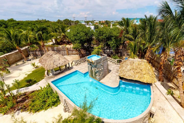 Upper-level resort suite with lovely views, shared pool, & nearby beach!