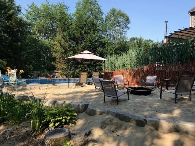 Newly added beach patio with fire pit next to pool !